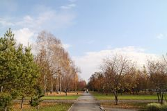 Walking tour in the autumn park. October. Walking tour in the autumn park Royalty Free Stock Photography