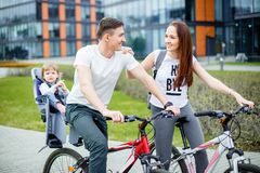 Walking tour. Happy family riding on bicycles stock image