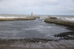 Walking tourism Yorkshire. A rough sea just outside Whitby Harbour on the North Yorkshire coast in England Stock Images