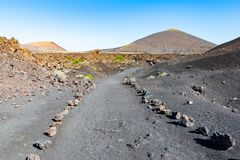 Walking Tourist Road around Caldera de los Cuervos, Timanfaya National Park, Lanzarote, Canary Islands, Spain.  royalty free stock images