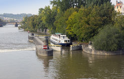 Walking tourist ship passes a lock on the Vltava River in Prague, Czech Republic Royalty Free Stock Photos