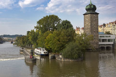 Walking tourist ship passes a lock on the Vltava River in Prague, Czech Republic Royalty Free Stock Photo