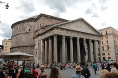 Walking tourists near the Pantheon in cloudy weather Stock Images