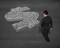 Walking toward 3d money shape maze Stock Images