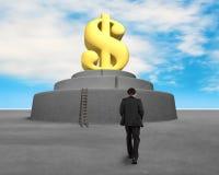 Walking toward large money symbol Royalty Free Stock Image