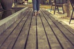 Walking toward on wooden walkway Stock Image