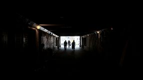 Walking Towards Light at End of Tunnel Royalty Free Stock Photos