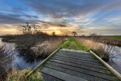 Walking track with bridge at sunset Stock Photo