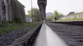 Walking by tracks stock footage