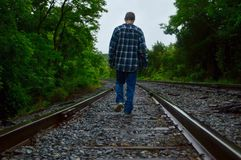 Boy walking on a train track Royalty Free Stock Photos