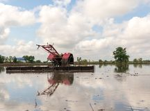 Walking Tractor on rice field for work plow farmland prepared for cultivation agricultural. Asian stock photo