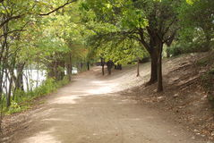 A walking trail along an urban river royalty free stock images