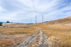 Walking trail among hills and valleys covered in dry grass, south San Francisco bay area, San Jose, California royalty free stock images