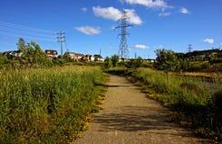 Walking Trail in the Neighborhood. A walking trail in the neighborhood in summer Royalty Free Stock Photo