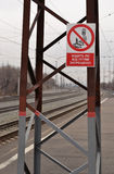 The Walking on train paths is prohibited on the background of railway lines. Royalty Free Stock Photo