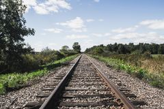 Train rails in the field royalty free stock photography