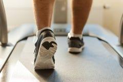 Walking on treadmill. Stock Photos