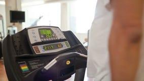 Walking on the treadmill stock video footage