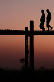 Walking on U-Bein bridge at sunset. Stock Photography
