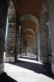 Walking under the Arches Stock Image