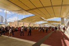 Walking under decumano  tensile roof, EXPO 2015 Milan. MILAN, ITALY - June 24: visitors walking under the tensile roof covering main walk at exhibition, shot  on Royalty Free Stock Image