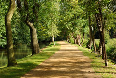 Walking into the Unknown. Pathway running along the riverside in Oxford Stock Photo