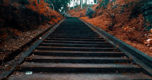 Walking up and down old staircase. Personal perspective point of view - colored video in slow motion stock video footage
