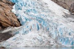 Walking up the glacier. Briksdal, Norway Royalty Free Stock Image