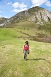Walking up on meadow at Picos de Europa Royalty Free Stock Image