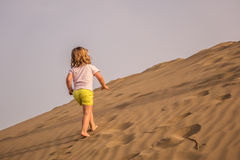 Walking up the sand dunes Stock Photography