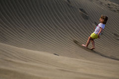 Walking up the sand dunes Stock Images