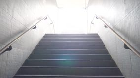 Walking up staircase. Exiting the metro stock video footage