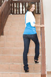 Walking up the stairs. An asian woman walking up the stairs from a different angle Stock Photos