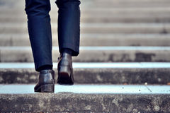 Walking up the stairs. Person walking up the stone stairs Royalty Free Stock Images