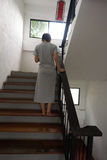Walking up the stairs. Young woman walking up the stairs Royalty Free Stock Image