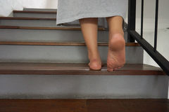 Walking up the stairs. Young woman walking up the stairs Stock Photography