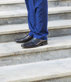 Walking upstairs: close-up view of man's leather shoes. royalty free stock photos