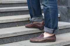 Walking upstairs: close-up view of man`s leather shoes Stock Photo