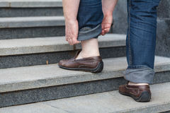 Walking upstairs: close-up view of man`s leather shoes Stock Photos