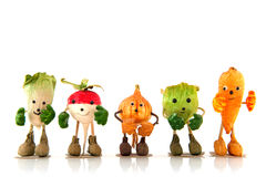 Walking vegetables. Funny vegetables with hands, feet and a face Stock Image