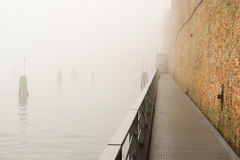 Walking in Venice in a foggy day, no people around Stock Images