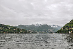 Walking view on Lake of Como and buildings in a cloudy rainy day, near Como. Stock Photos