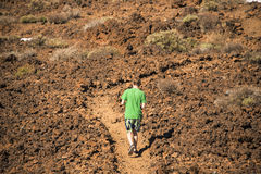 Walking in volcanic landscape stock photos
