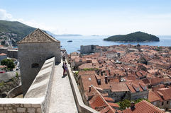 Walking on the Walled City of Dubrovnic in Croatia Europe. Dubrovnik is nicknamed `Pearl of the Adriatic. Dubrovnik is one of the most beautiful towns in the Stock Photography