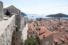 Walking on the Walled City of Dubrovnic in Croatia Europe. Dubrovnik is nicknamed `Pearl of the Adriatic. Dubrovnik is one of the most beautiful towns in the Stock Images