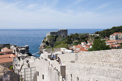 Walking on the Walled City of Dubrovnic in Croatia Europe. Dubrovnik is nicknamed `Pearl of the Adriatic. Dubrovnik is one of the most beautiful towns in the Royalty Free Stock Photos