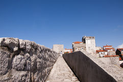Walking in the Walled City of Dubrovnic in Croatia Europe. Dubrovnik is nicknamed `Pearl of the Adriatic. Dubrovnik is one of the most beautiful towns in the Royalty Free Stock Image