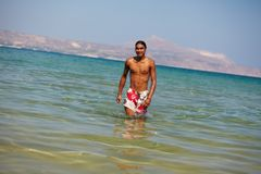 Walking in water Royalty Free Stock Image