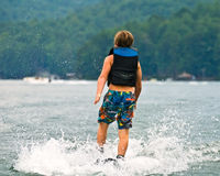Walking on Water/Boy Skiing. A young boy who has just lost the rope and is about to fall royalty free stock photos