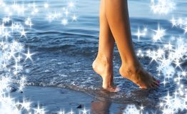 Walking on water with snowflakes stock image